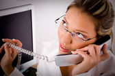 Young professional talking on phone — Stock Photo