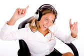 Young manager enjoying music — Stock Photo