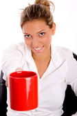 Smiling woman offering coffee — Stock Photo