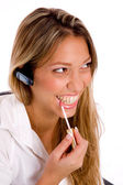 Service provider applying lipstick — Stock Photo