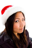 Young female in christmas hat winking — Stock Photo