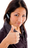 Young female service provider with thumb — Stock Photo