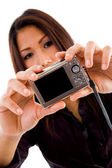 Attractive asian woman holding camera — Stock Photo