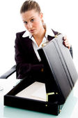 Businesswoman with opened briefcase — Stock Photo