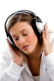 Young woman tuned in music — Stock Photo