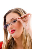 Female model holding her spectacles — Stock Photo