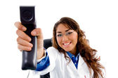 Smiling doctor showing phone receiver — 图库照片