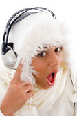 Surprised girl tuned in music — Stock Photo