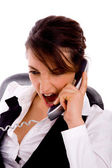 Angry young businesswoman on call — Stock Photo