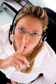 Service provider instructing silence — Stock Photo