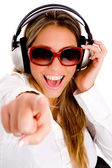 Pointing female enjoying music — Stock Photo