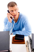 Phone call in office at desk — Stock Photo