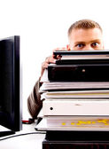 Professional man peeping from files — Stock Photo