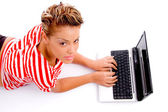 Woman with laptop looking at camera — Stock Photo