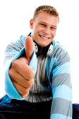 Young happy male with thumbs up — Stock Photo