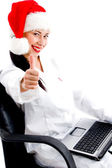 Surgeon in christmas hat with thumbs up — Stock Photo