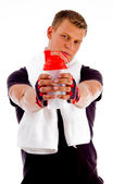Young man holding water bottle — Stock Photo