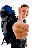 Handsome young traveler with luggage — Stock Photo