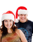 Brunette happy couple in christmas hat — Stock Photo