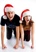 Christmas couple winking at camera — Stock Photo