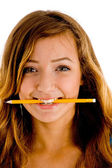 Pretty girl with pencil in her mouth — Stock Photo