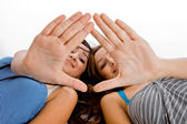 Caucasian girls showing palms to camera — Foto Stock
