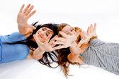 Happy caucasian girls lying on floor — Stock Photo