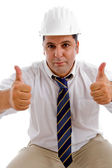 Young architect with good luck gesture — Stock Photo