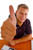 American male showing good luck sign — Stock Photo