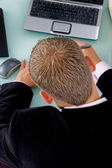 Back pose of working businessman — Stock Photo
