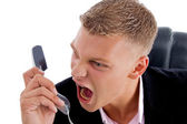 Angry boss shouting on phone — Stock Photo