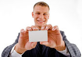 Professional holding business card — Stock Photo
