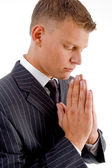 Side pose of praying businessman — Stock Photo
