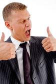 Handsome businessman winking — Stock Photo