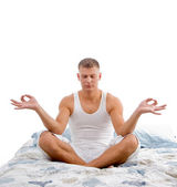 Young man in lotus pose — Stock Photo