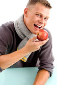 Smiling young man posing with apple — Stock Photo