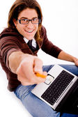 Smiling man with laptop and pencil — Stock Photo