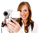 Smiling female carrying video camera — Stock Photo