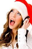Christmas woman listening music — Stock Photo