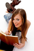 Smiling woman studying — Stock Photo