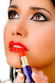 Portrait of beautician applying lipstick — Stock Photo