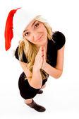 Praying female wearing christmas hat — Stock Photo