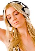 Sensuous model listening music — Stock Photo