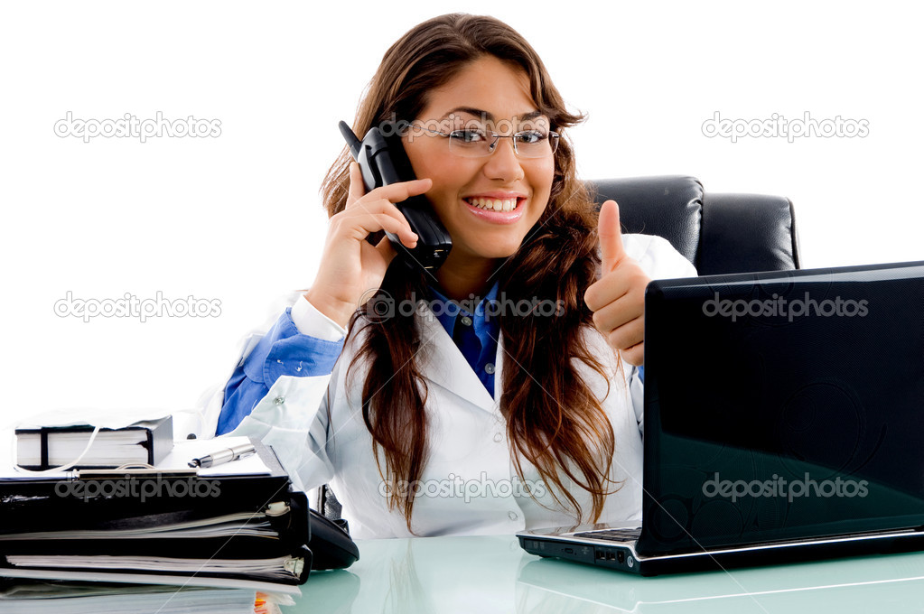 Smiling doctor with thumbs up in an office — Stock Photo #1351454