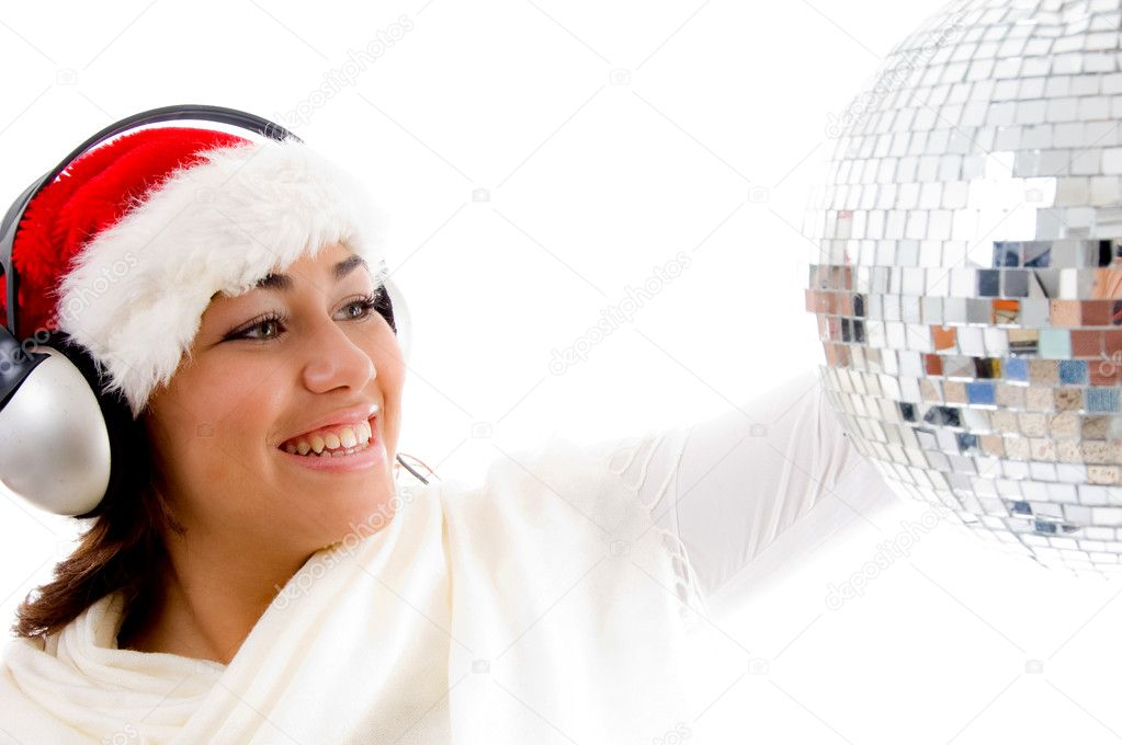 Gorgeous girl with christmas hat and wearing headphones with white background  Stock Photo #1351504