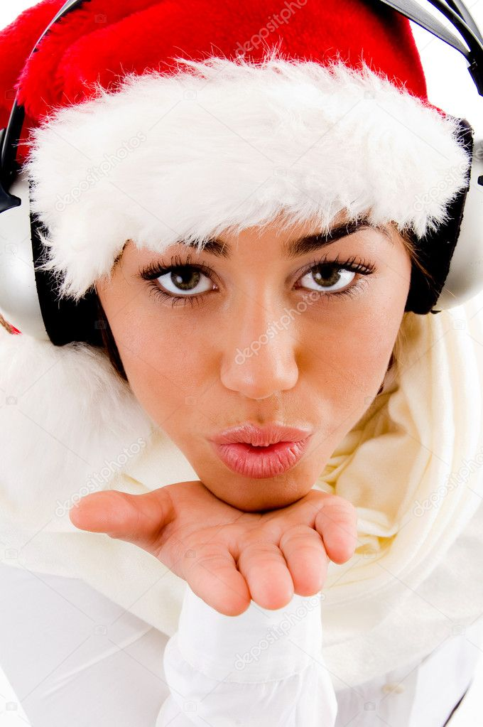 Pretty woman wearing christmas hat giving blowing a kiss with white background  Stock Photo #1351510