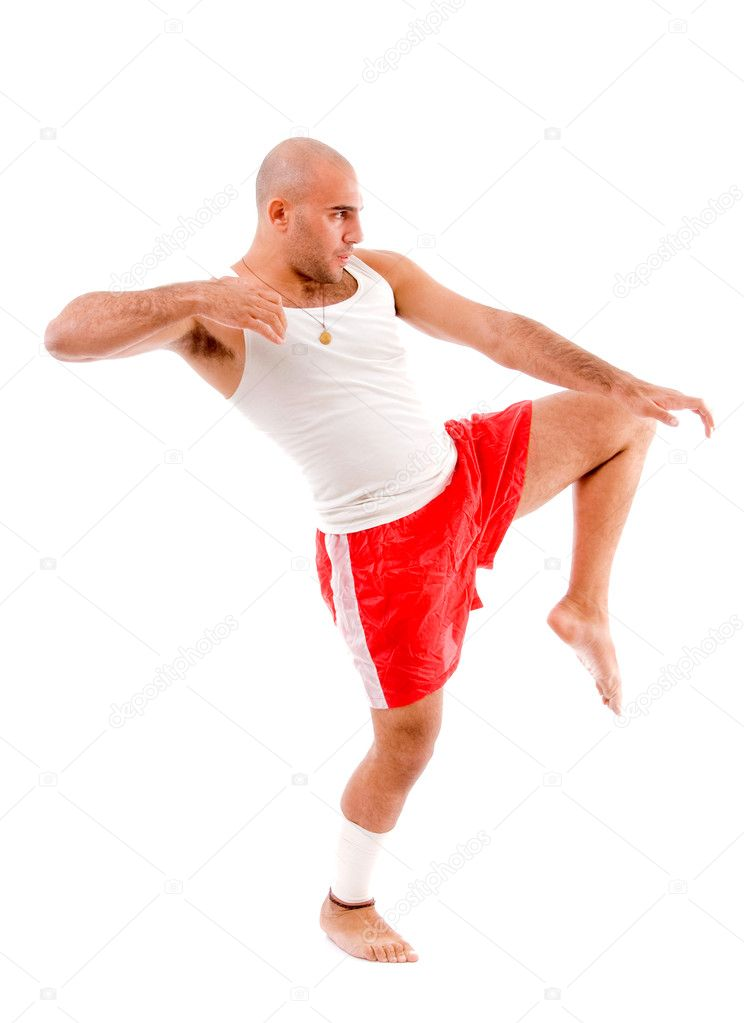 Muscular man in fighting posture on an isolated background — Stock Photo #1352672