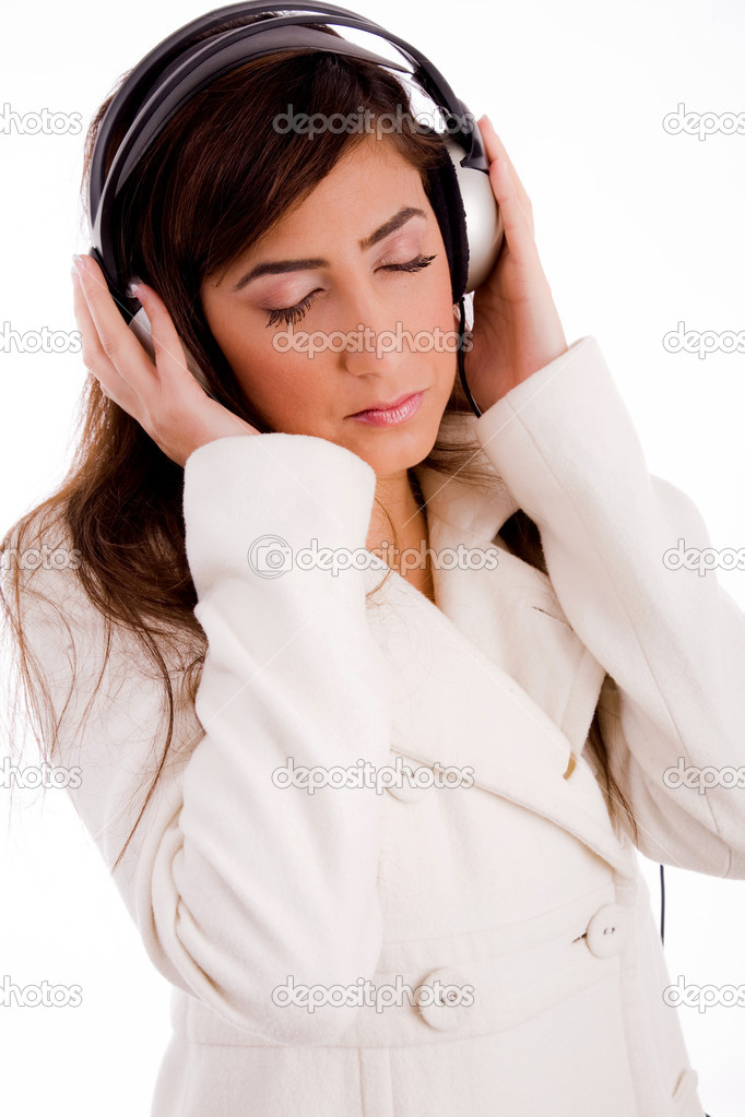 Portrait of young female enjoying music against white background — Stock Photo #1356367