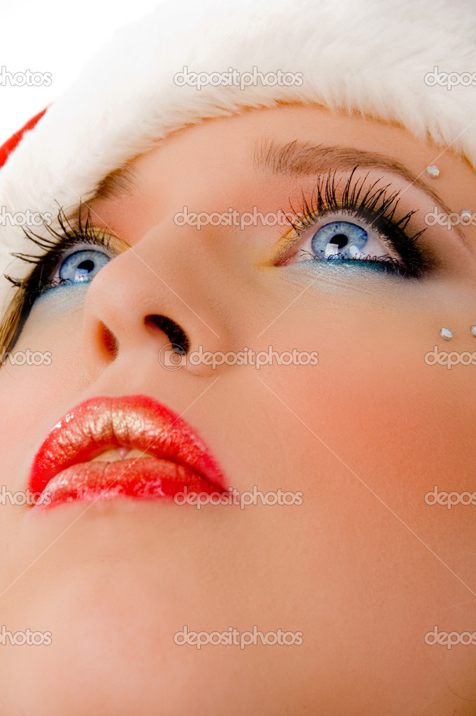 Close view of christmas woman looking up against white background — Stock Photo #1357923
