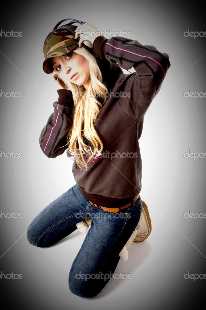 Top view of young model enjoying music on an isolated background — Stock Photo #1358127